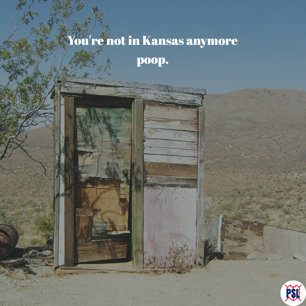An outhouse in a desert location